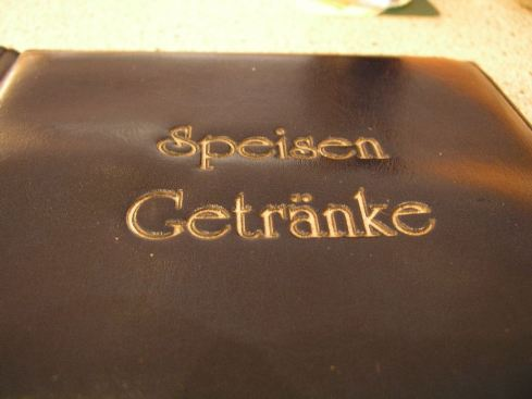 Speisekarte in braunem Kunstleder, Aachen 2005